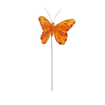 Distelvlinder op stick licht oranje